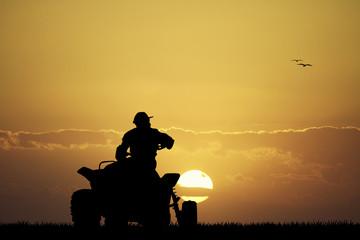man on the quad at sunset