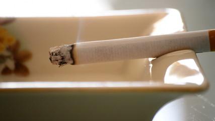 Burning Cigarette In Ashtray