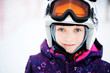 Young girl skier in winter resort