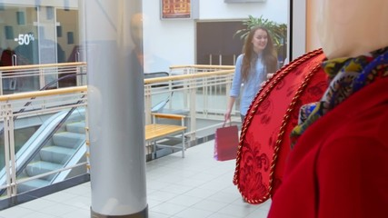 Two beautiful girls with shopping bags suited to showcase at the