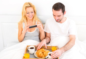 young attractive woman taking pictures of breakfast