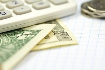 Business calculator and money closeup