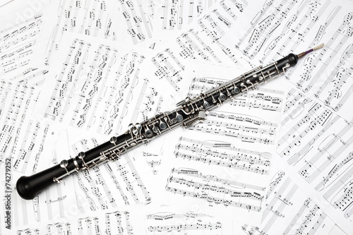 Oboe with music sheet notes classical musical instruments - 74279252
