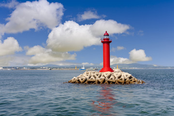 red lighthouse and clear sky