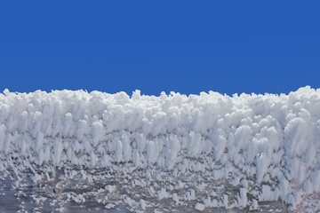 Close up of a wooden fence covered with ice crystals