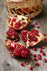 fresh pomegranate on wooden background