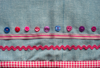 sewing buttons and fabric background