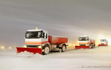 Snowplow Trucks Removing the Snow
