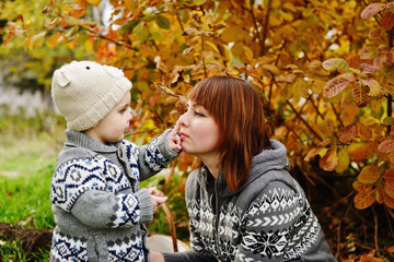boy with mother in fall