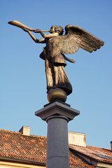 the angel playing the horn
