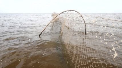 fishing net  a fish-trap on lake