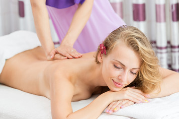 Relaxing massage for woman in spa salon