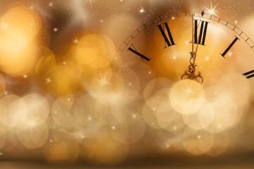 New Year at midnight: Old clock and holiday lights