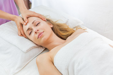 woman having spa massage of her head