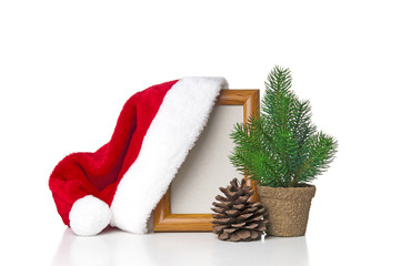 Christmas hat hung on frame isolated on white background