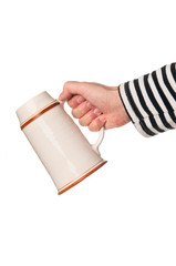 Hand holding mug beer