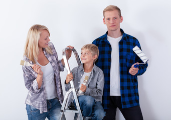 Couple with child during home renovation