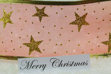 Merry Christmas card with red ribbon with golden stars