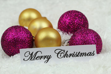 Merry Christmas card with golden and purple baubles