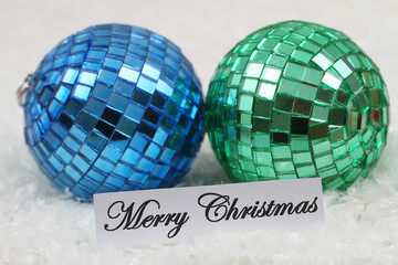 Merry Christmas card with blue and green baubles