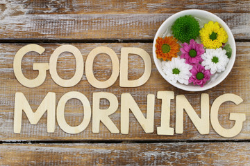 Good morning written with wooden letters and santini flowers