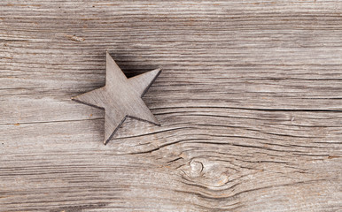 Old xmas star on wooden vintage background