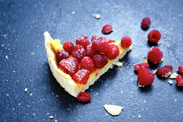 Sweet dessert, a slice of cake with raspberries