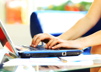 a female learner typing on the laptop keyboard