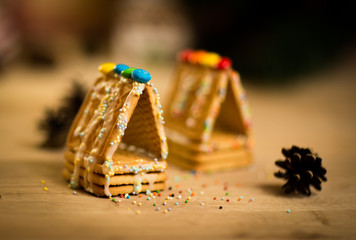 beautiful gingerbread house on wooden background