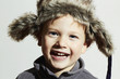 smiling child in fur Hat.Kids winter.little funny boy.children
