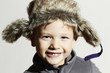 smiling child in fur Hat.fashion casual winter.little funny boy