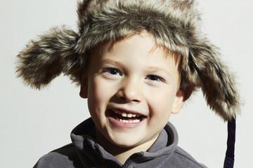 smiling child in fur Hat.Kids winter.little funny boy.children