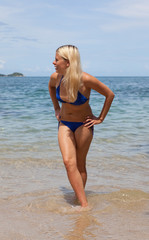blonde in a bathing suit on the beach