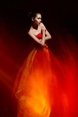 Elegant girl in fluttering red dress