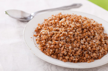 boiled buckwheat porridge in plate
