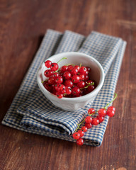 Red currant berries with green leaves