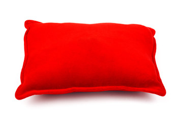 Soft red pillow on white
