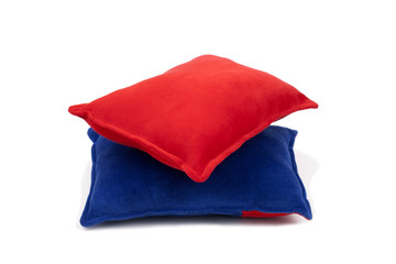 pink blue cushions over white background