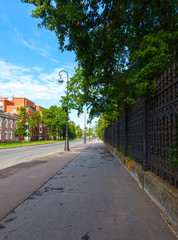 pavement and cast-iron fence