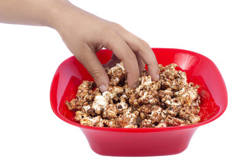 hand winter chocolate popcorn in bowl isolated on white