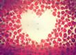 Obrazy na płótnie, fototapety, zdjęcia, fotoobrazy drukowane : Rose flower petals making a heart shape on vintage romantic sky