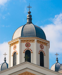 White orthodox church towers against the blue sky.