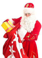 Santa with bag of presents. Isolated on white.