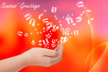 Seasons greetings card with hand open on red background