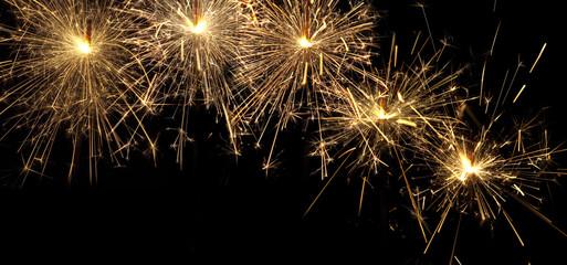 burning christmas sparklers isolated on black background