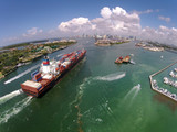 Cargo ship enters port aerial view