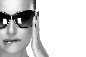 Beautiful Model in Black Fashion Sunglasses. Beauty and Makeup
