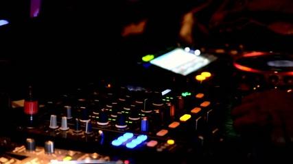 DJ at mixing station
