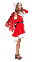 Beautiful Santa Claus woman holding shopping bags