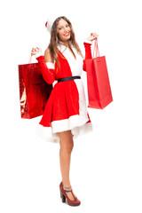 Female Santa Claus holding shopping bags